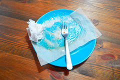 Empty dirty plate on wooden table left after lunch Royalty Free Stock Photos