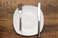 Empty dish, knife and fork Royalty Free Stock Photography