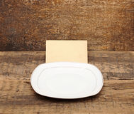 Empty dish with old paper Royalty Free Stock Image
