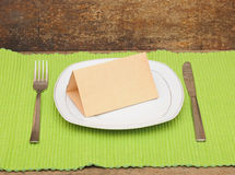 Empty dish with old paper, knife and fork Royalty Free Stock Photography