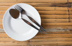 Empty dish with spoon and fork Stock Images