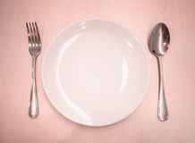 Empty dish with spoon and fork Royalty Free Stock Image