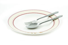 Empty dish spoon and fork Royalty Free Stock Photos