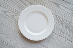 Empty dish on the wood table Royalty Free Stock Image