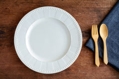 Empty dish with wooden spoon and fork on old wood Stock Images