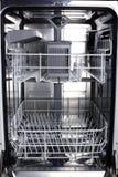 Empty dishwasher royalty free stock photos