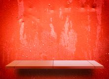 Empty display shelf on Shiny red metal Royalty Free Stock Images