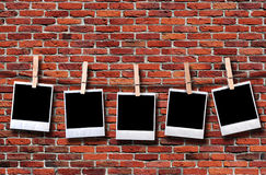 Empty disposable photo frames hanging in rope stock photography