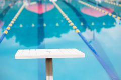 Empty diving block looking down pool race lane - horizontal Stock Photos