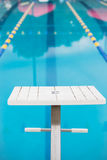 Empty diving block looking down pool race lane Stock Image