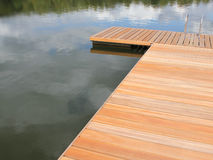 Empty dock in calm lake of Weiswampach Royalty Free Stock Photos
