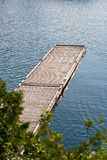 An empty dock extending into the water Stock Photography
