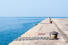 Empty dock in the harbor of Trieste. With chain in the foreground Stock Photography