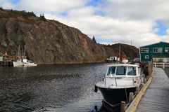 Almost empty docks for fishing boats in October - Quidi Vidi Stock Image