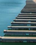 Empty docks at a marina. Empty boat docks form a pattern at a marina royalty free stock image