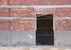 Empty Door Opening with Wires and Materials Royalty Free Stock Photography