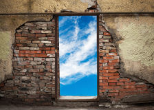 Empty doorway with sky in old brick wall Stock Images