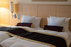 Empty Double Bed in Hotel stock photography