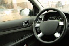 The empty driver's place in car. Steering wheel closeup Stock Photography