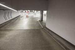 Empty driveway in concrete parking garage Stock Photography