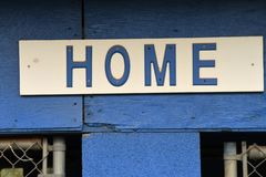 Baseball Dugout. Empty dugout at a baseball field with the home sign on it stock photo