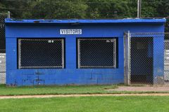 Baseball Dugout. Empty dugout at a baseball field with the visitors sign on it royalty free stock image