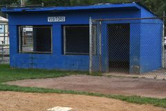 Baseball Dugout. Empty dugout at a baseball field with the visitors sign on it royalty free stock images