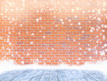 Empty dye brick wall with ice cover a wooden floor and snowing , Royalty Free Stock Photos