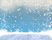 Empty dye brick wall with ice cover a wooden floor and snowing , Royalty Free Stock Image