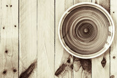 Empty earth tone plate on wooden background. Top view with copy. Space royalty free stock images