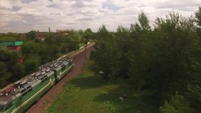 Empty electric freight train, locomotive moves rides by rail without wagons in city, town. Aerial view, drone, air shoot.  stock video
