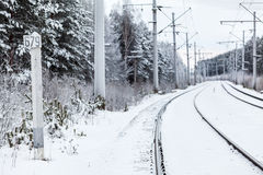 Empty electric mainline railway in winter Royalty Free Stock Photography