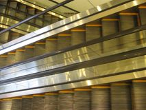 Empty electric stairs, aerial view of automatic escalators in motion and without people. 