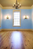 Empty elegant diningroom. With blue walls and window, place your own furniture Royalty Free Stock Images