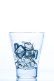 Empty elegant glass with water and ice Stock Image