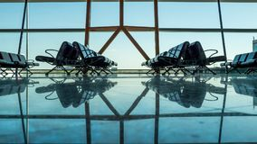 Empty empty airport terminal with passenger seats.  Stock Image
