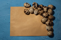 Empty envelope quail eggs on a blue background texture. Empty envelope, quail eggs on a blue background texture Stock Image