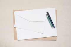 Empty envelope and sheet of paper on the table Royalty Free Stock Photos