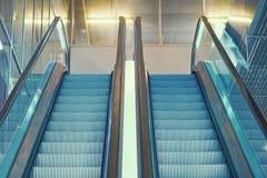 Empty escalator inside a glass building royalty free stock image