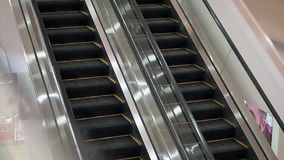 Empty escalator in the mall, it works.  stock footage