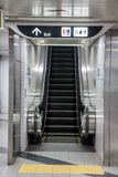 Empty escalator from the metro station. Exit of the subway on the moving stairs Royalty Free Stock Photography