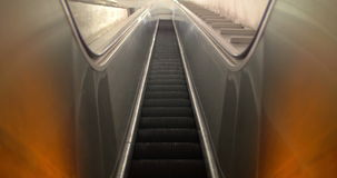 Empty escalator moving up. Low angle shot of empty escalator in underground with steps moving up stock video footage