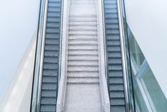 Empty escalator and stair Royalty Free Stock Images