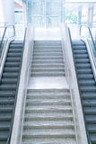 Empty escalator and stair Royalty Free Stock Photo