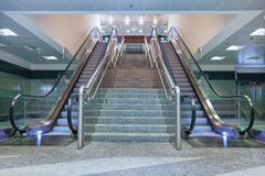 Empty escalator stairs Stock Photos