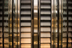 Empty escalator stairs in modern building Stock Photo