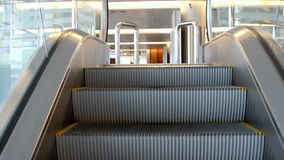 Empty escalator stairs moving up with logo warning stock video