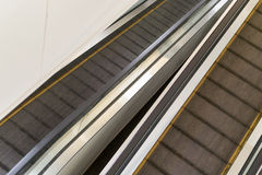 Empty Escalators in Diagonal Composition. Empty escalators in a modern office shopping center with nobody and copyspace stock photos