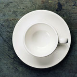 Empty espresso cup on a saucer Stock Photos