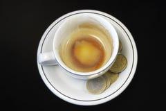 Empty Espresso and Tip in Euros Stock Photo